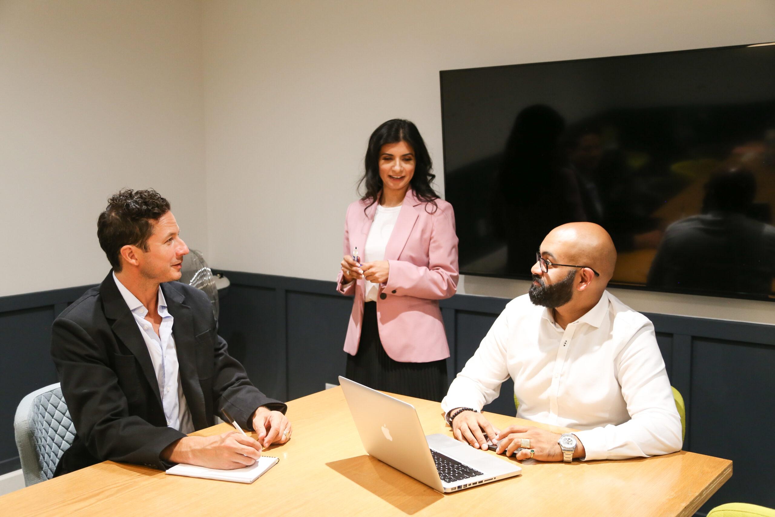 Diverse team members in a meeting room